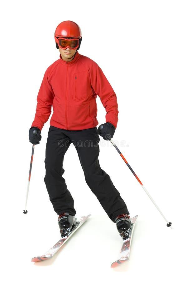 Giovane uomo di corsa con gli sci fotografia stock