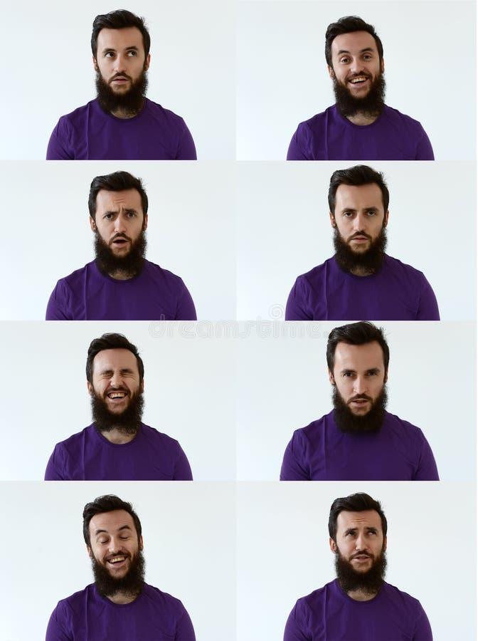 Giovane uomo emozionale con una barba e una camicia porpora che esaminano la macchina fotografica in uno studio su un fondo bianc fotografia stock
