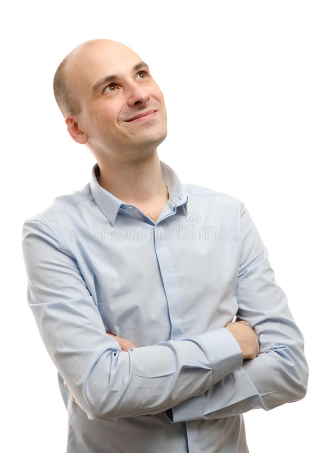 Giovane uomo felice di affari che osserva in su fotografia stock libera da diritti