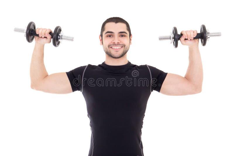 Giovane uomo forte in abiti sportivi neri che fanno gli esercizi con dumbbe fotografia stock libera da diritti