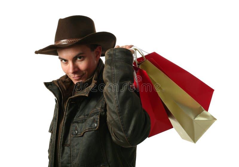 Giovane uomo sexy con i sacchetti di acquisto fotografie stock