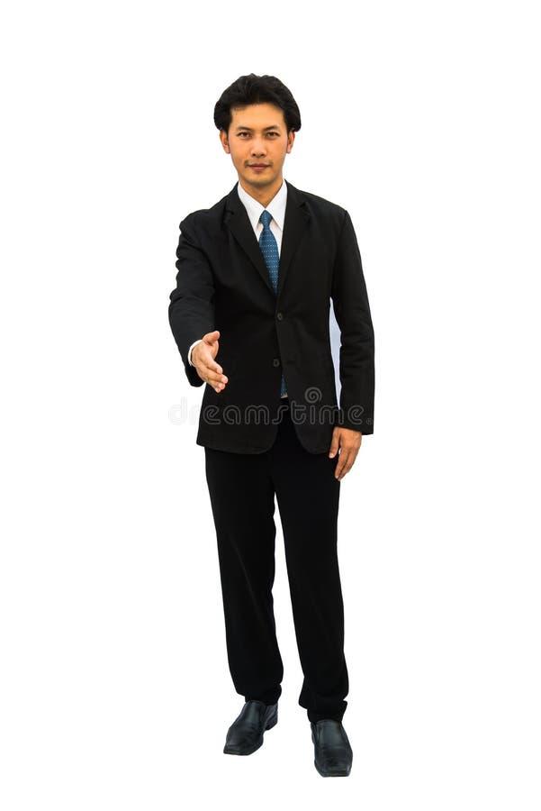 Giovane uomo sorridente felice di affari che dà mano per la stretta di mano fotografie stock libere da diritti