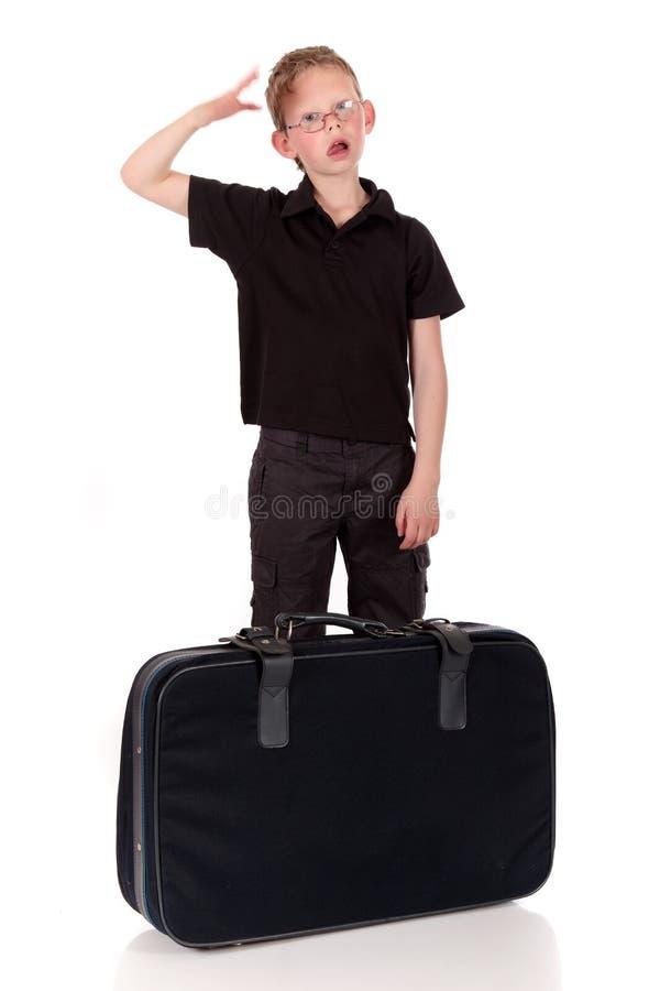 Giovane valigia del ragazzo fotografia stock