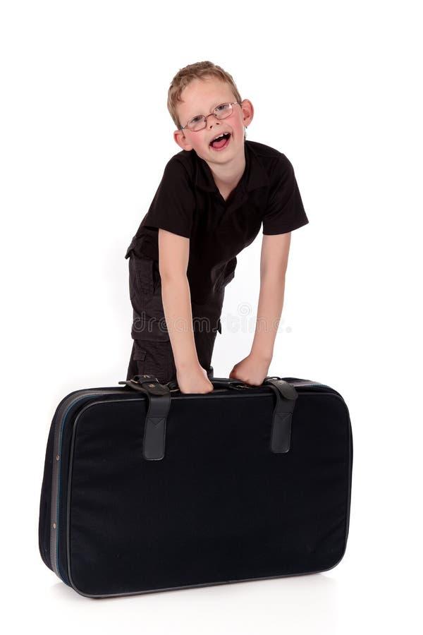 Giovane valigia del ragazzo fotografia stock libera da diritti