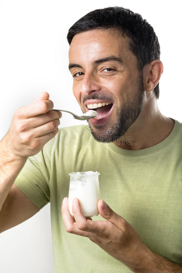Giovane Yogurt Mangiatore Di Uomini Fotografia Stock