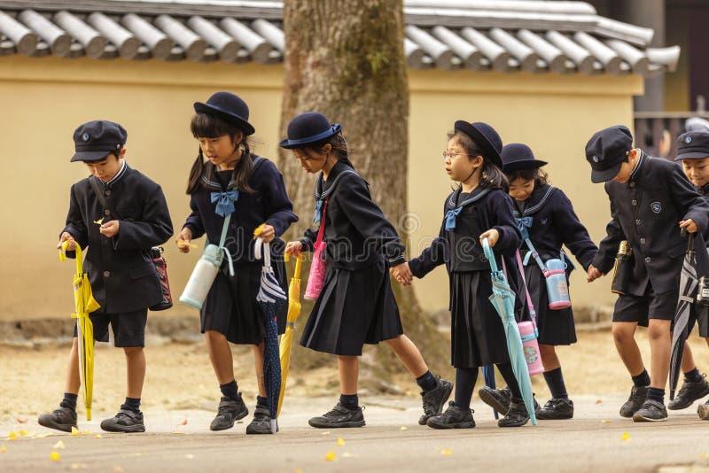 Giovani allievi giapponesi immagine stock libera da diritti