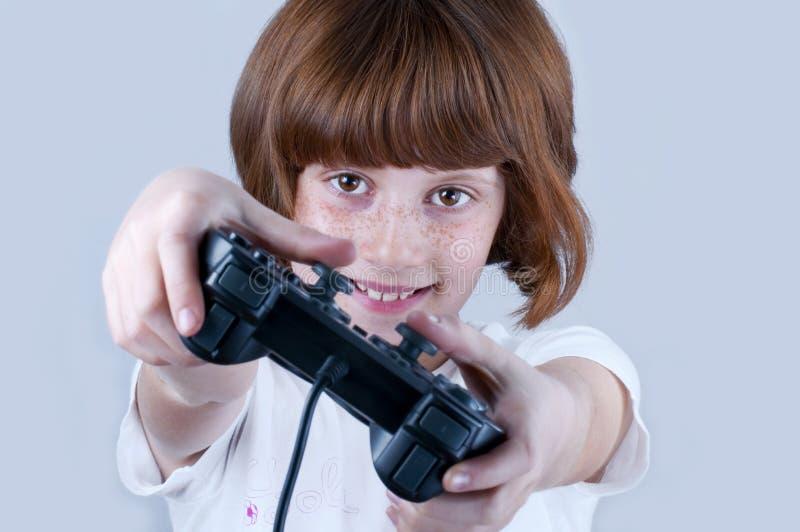 Giovani che giocano i giochi fotografia stock