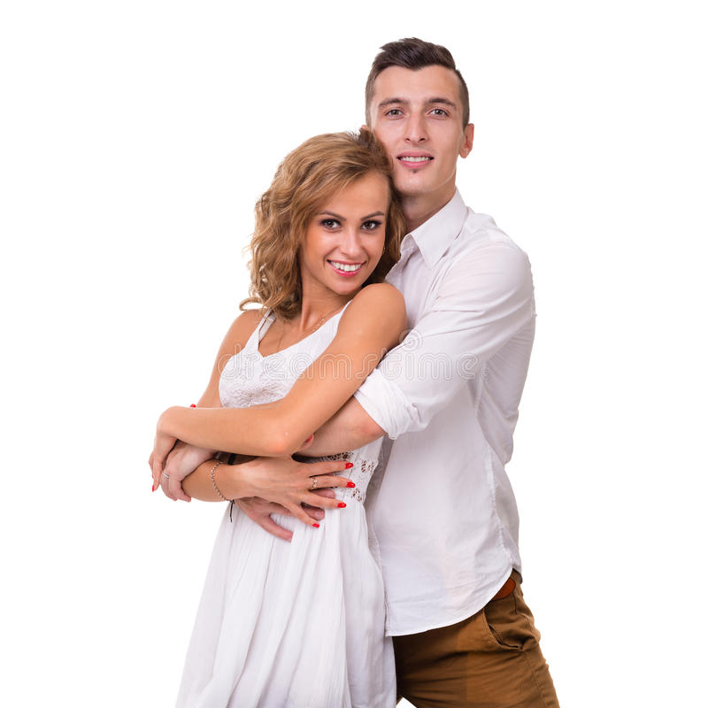 Giovani coppie allegre su fondo bianco immagini stock