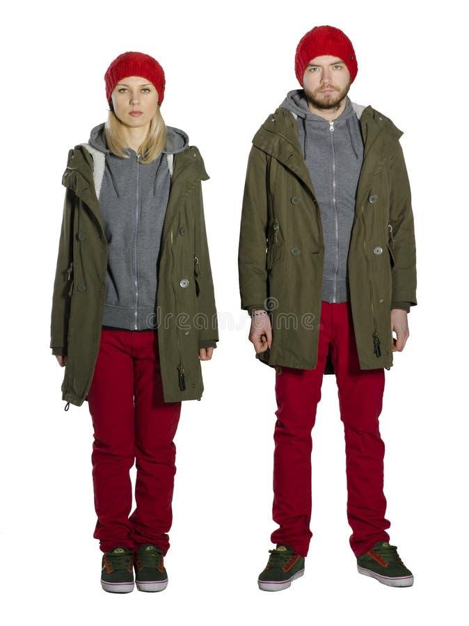 Giovani coppie che indossano gli stessi vestiti fotografie stock