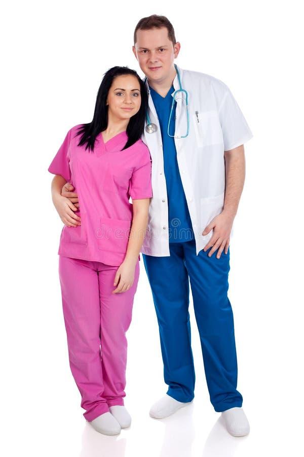 Giovani coppie del medico e dell'infermiera immagine stock libera da diritti