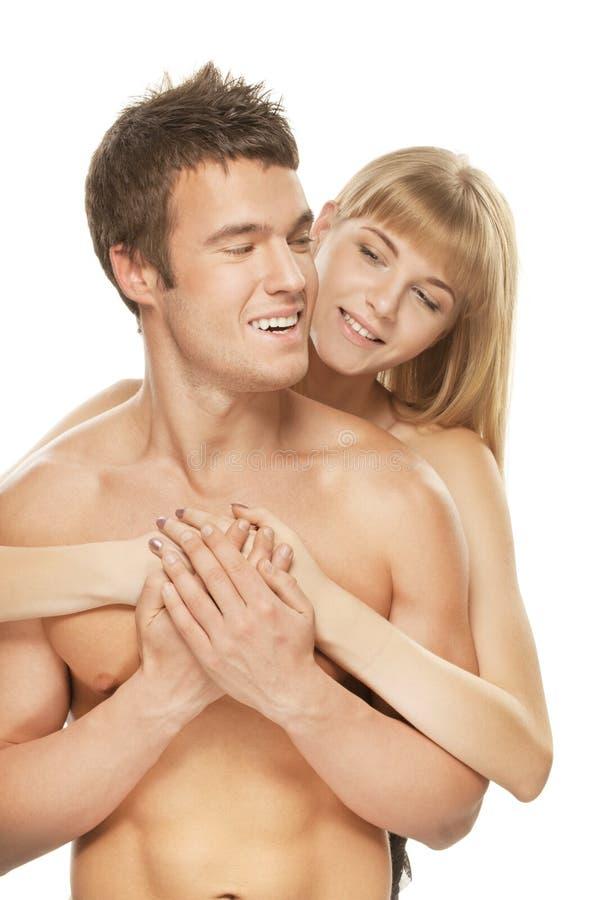 Giovani coppie felici contro fondo bianco immagine stock