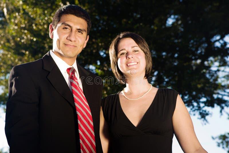 Giovani coppie felici di affari fotografie stock libere da diritti