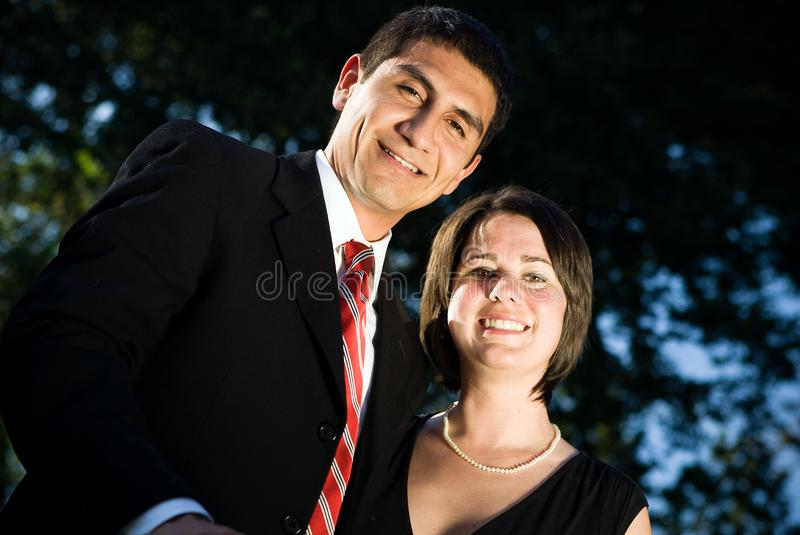 Giovani coppie felici di affari immagine stock libera da diritti