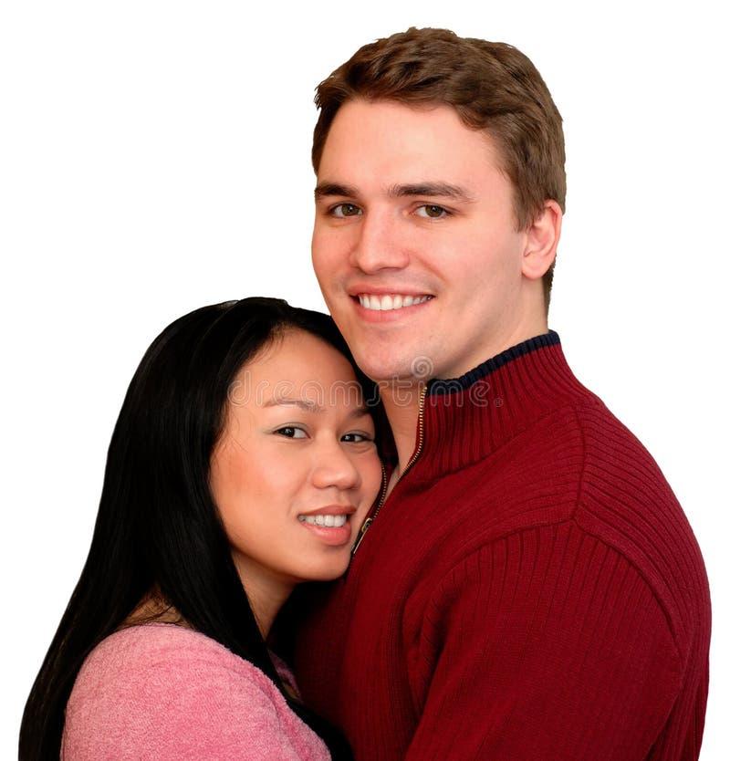 Giovani coppie felici, isolate fotografia stock
