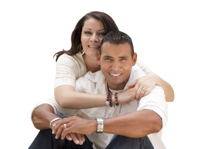 Giovani coppie ispane felici isolate su bianco fotografia stock libera da diritti