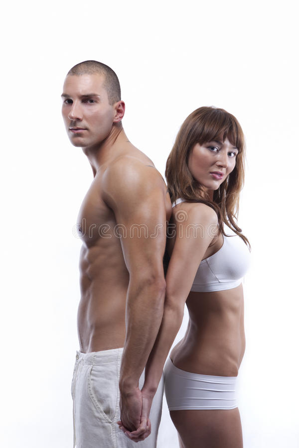 Giovani coppie sexy nel bianco fotografie stock