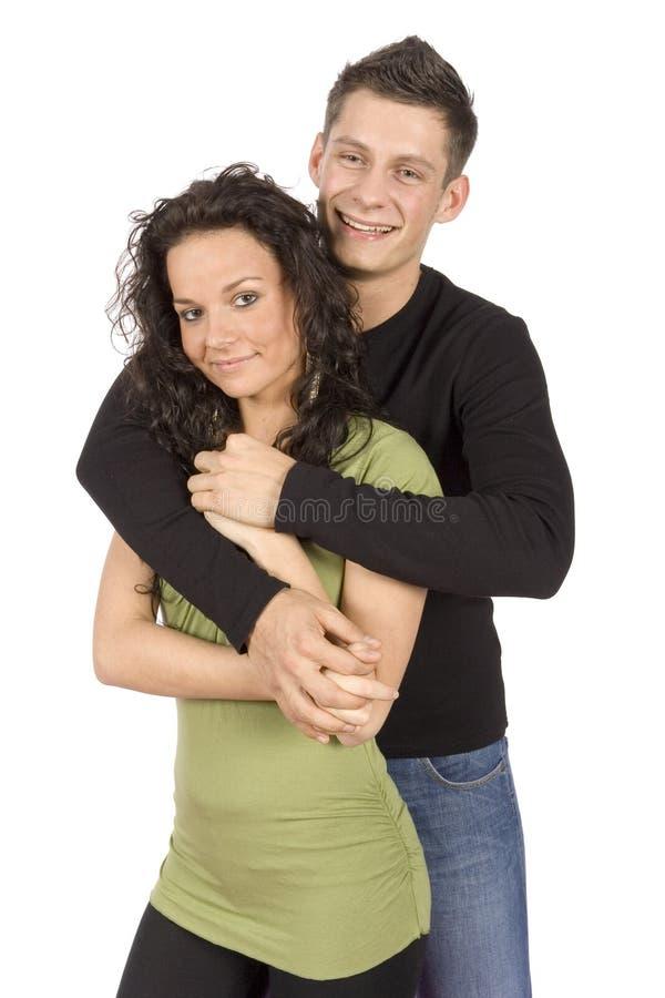 Giovani coppie snuggling fotografie stock libere da diritti