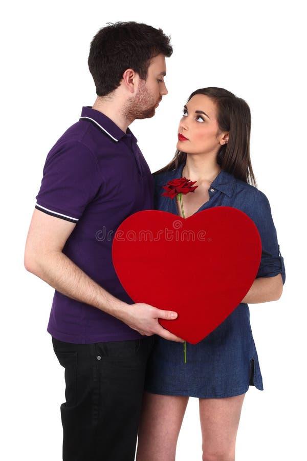 Giovani coppie su bianco fotografie stock libere da diritti