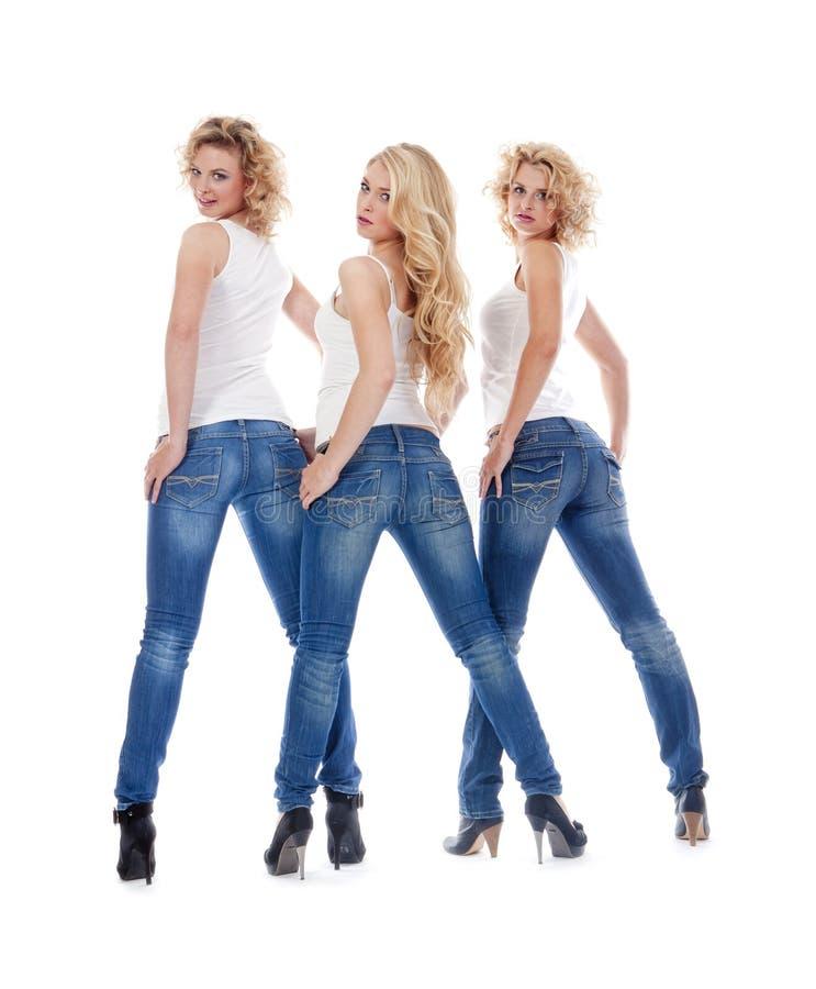Giovani donne in abbigliamento casuale - isolato su bianco immagini stock