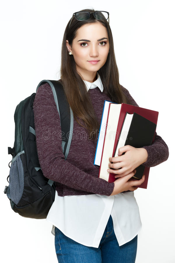 Giovani libri allegri attraenti della tenuta della studentessa, isolati su fondo bianco fotografia stock libera da diritti
