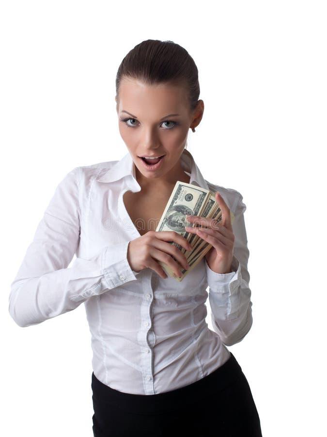 Giovani lotti sexy dell'introito della donna di affari di soldi fotografie stock