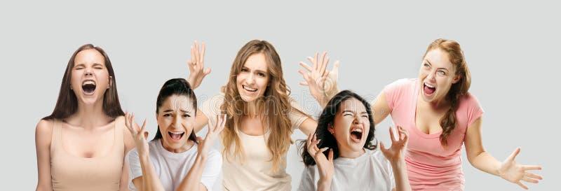 Giovani nello sforzo isolati sul fondo bianco dello studio fotografia stock