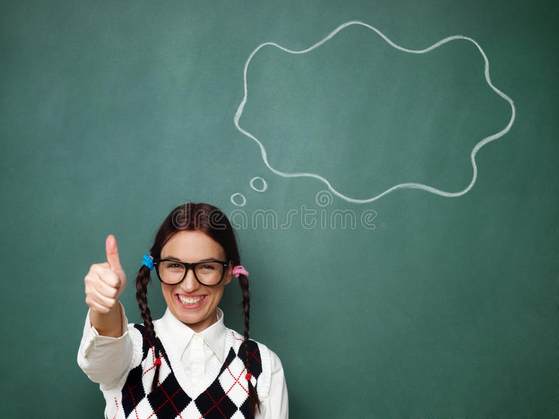 Giovani pollici femminili del nerd su immagine stock libera da diritti