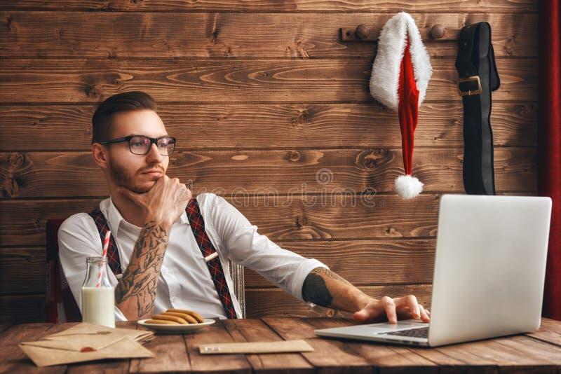 Giovani Santa Claus dei pantaloni a vita bassa fotografia stock