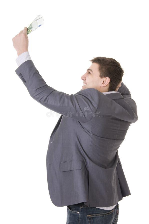 Giovani soldi felici della holding dell'uomo d'affari fotografia stock libera da diritti