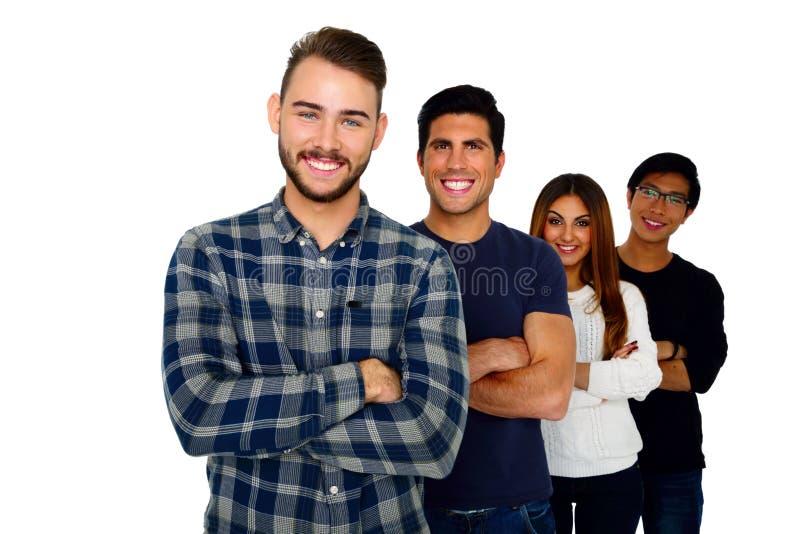 Giovani studenti allegri che stanno in una fila fotografie stock libere da diritti