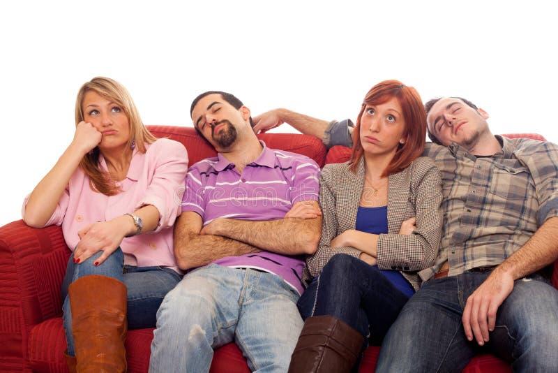 Giovani sul sofà immagine stock