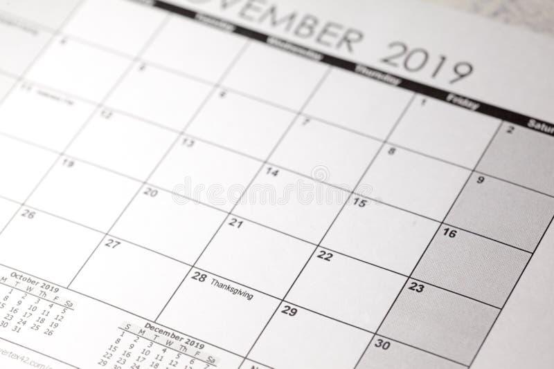 Giovedì 28 novembre Ringraziamento negli Stati Uniti 2019 nel fuoco selettivo sul calendario immagine stock libera da diritti