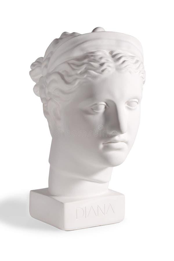 Gipshuvud av gammalgrekiskagudinnan Diana arkivfoto