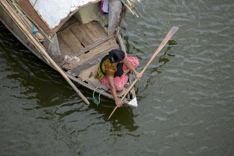 A gipsy women and her family traveling a boat through the Ichamoti River, near of Dhaka city. Bengali revering country. The country`s low-lying areas most of stock image