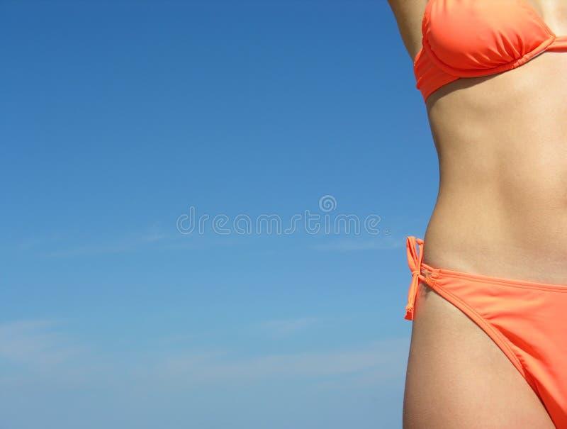 Gir's body on blue sky stock photo