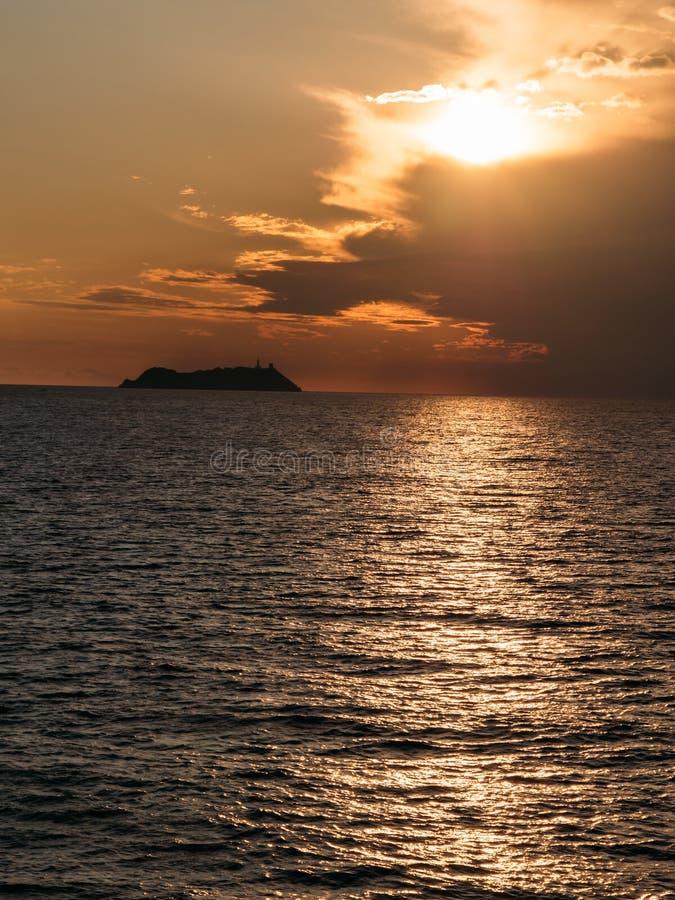 Giraglia wyspa przy zmierzchem: northest punkt Corsica obrazy royalty free