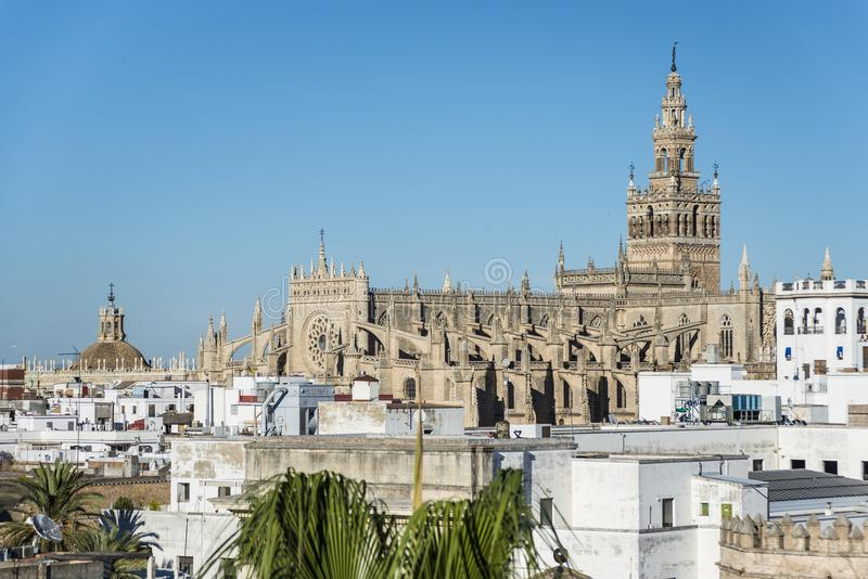 The Giralda in Seville, Andalusia, Spain. The Giralda La Giralda, a former minaret converted to a bell tower for the Cathedral of Seville in Seville, Andalusia royalty free stock images