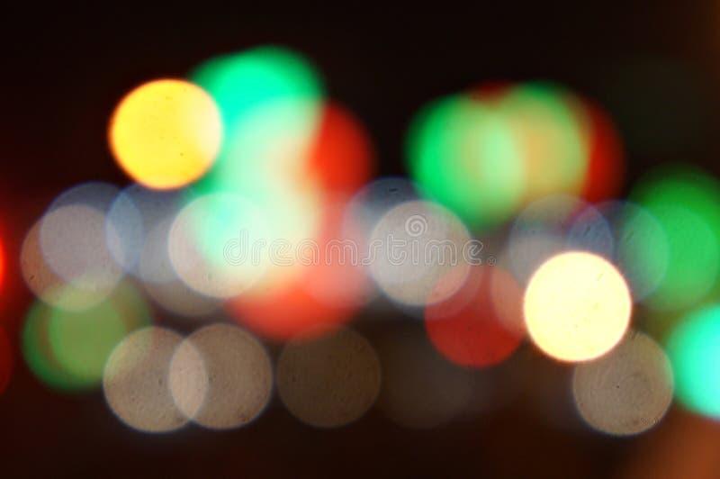 Girare e girare intorno alle luci colorate... fotografie stock