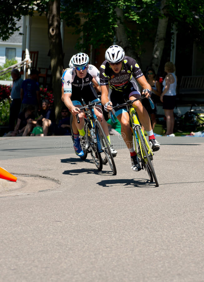 Girkins Leads at Stillwater Criterium. Stillwater, Minnesota, USA – June 21, 2015: Cyclist Kevin Girkins leads race as Ben Hill closes in at stage six stock image
