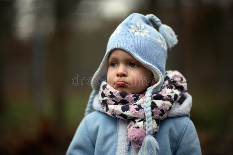 Girl. A little girl in cold winter royalty free stock image