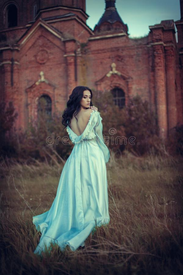 The girl, about the abandoned Church stock photo