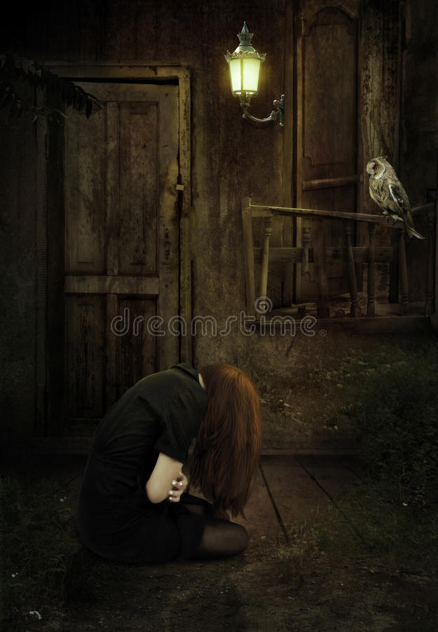 The girl in an abandoned house royalty free stock photo