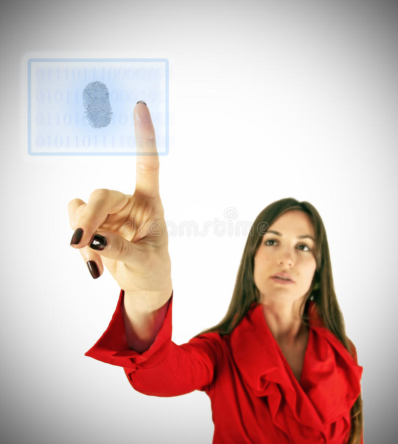 Girl with access button. Girl in red touch virtual display with finger. Modern technology concept stock photo