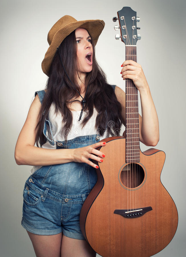 Girl with acoustic guitar royalty free stock photography