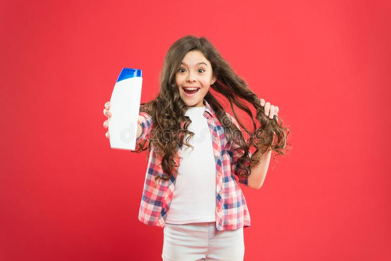 Girl active kid with long hair. Dry shampoo. Easy tips making hairstyle for kids. Strong and healthy hair concept. Long royalty free stock images