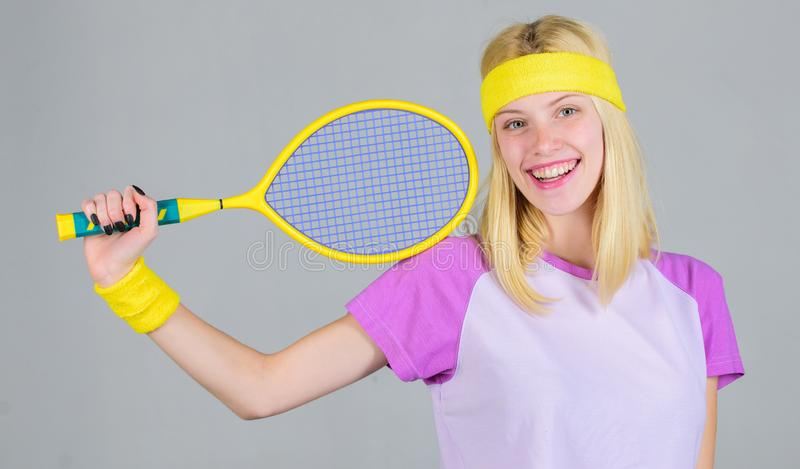 Girl adorable blonde play tennis. Sport for maintaining health. Active leisure and hobby. Athlete hold tennis racket in royalty free stock photo