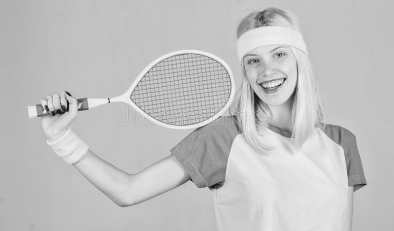 Girl adorable blonde play tennis. Sport for maintaining health. Active leisure and hobby. Athlete hold tennis racket in royalty free stock image