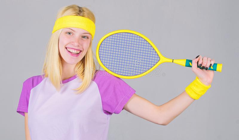 Girl adorable blonde play tennis. Sport for maintaining health. Active leisure and hobby. Athlete hold tennis racket in royalty free stock photography