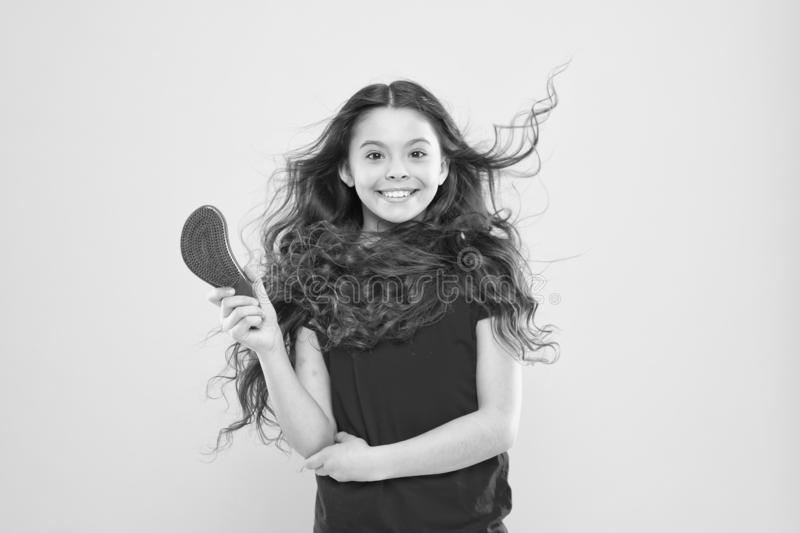 Girl adorable kid long wavy hair yellow background. Wind can also damage hair. Things you doing to damage your hair. Strong persistent winds can create tangles stock photos