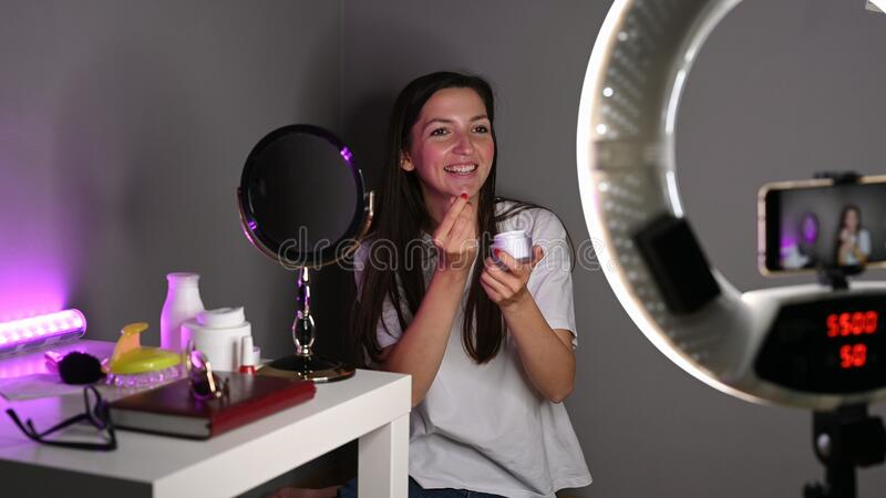 Girl advertises cosmetics over the Internet. High quality photo stock photos